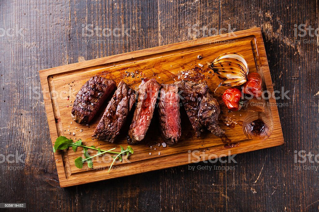 Sliced steak Ribeye with onions and tomatoes stock photo