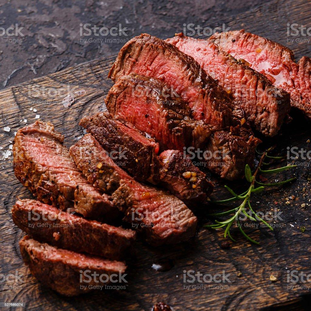 Sliced steak roastbeef and rosemary stock photo