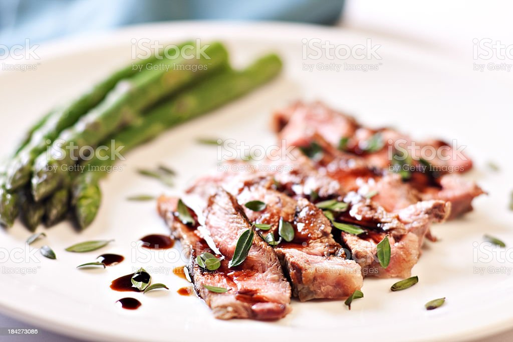 Sliced steak with asparagus royalty-free stock photo