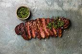 Sliced steak with chimichurri sauce