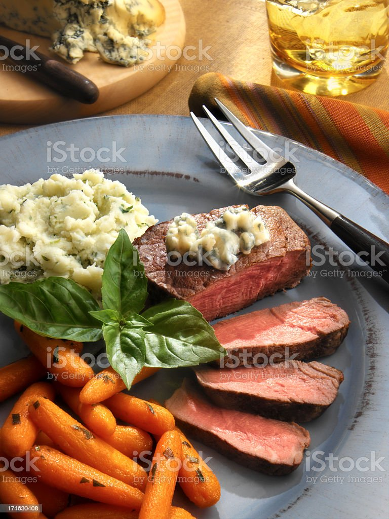 Sliced steak with mashed potatoes and carrots stock photo