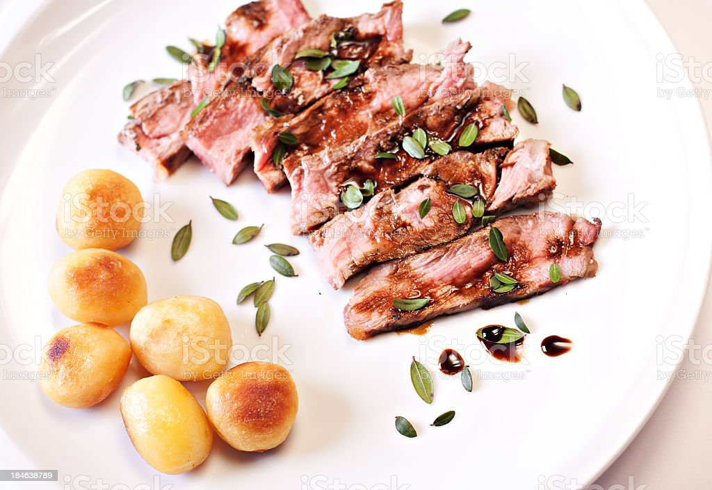 Sliced steak with potatoes royalty-free stock photo