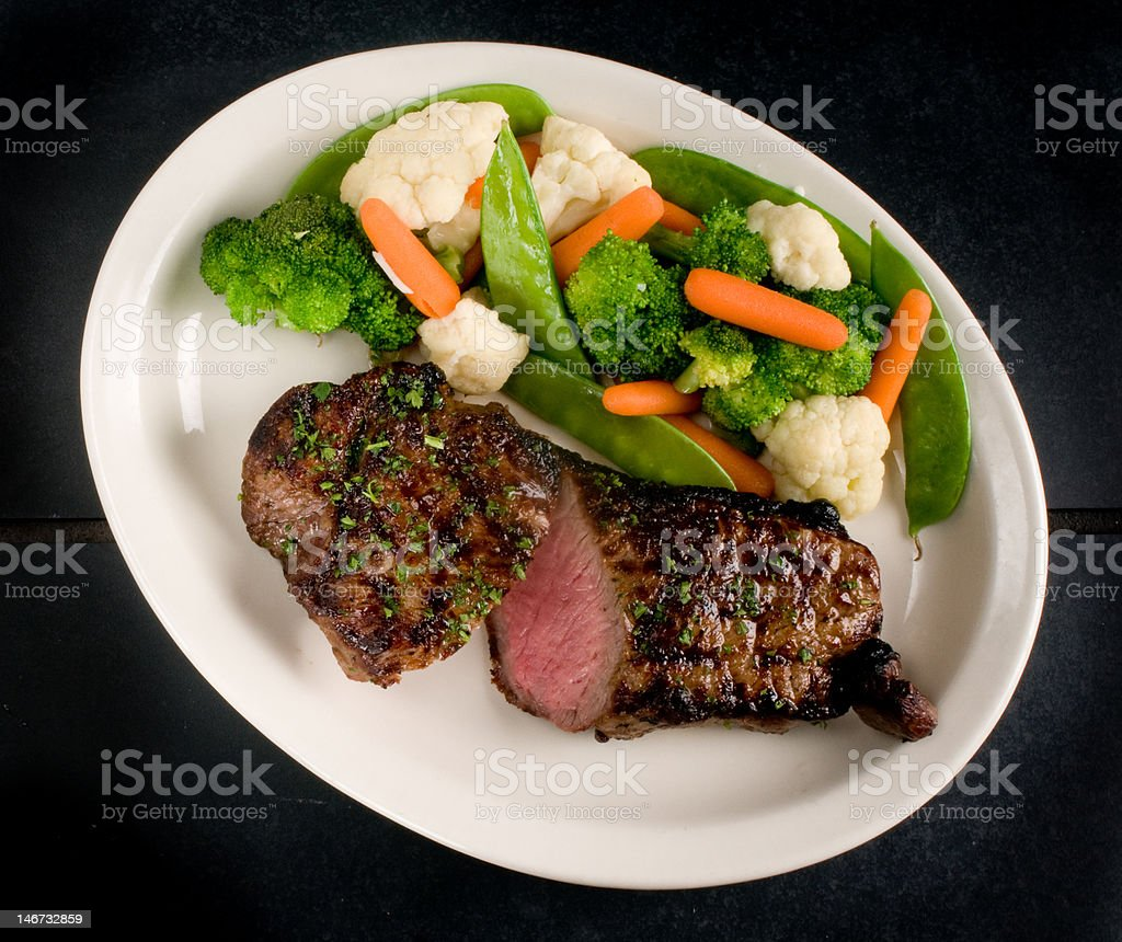 Sliced steak with steamed vegetables stock photo