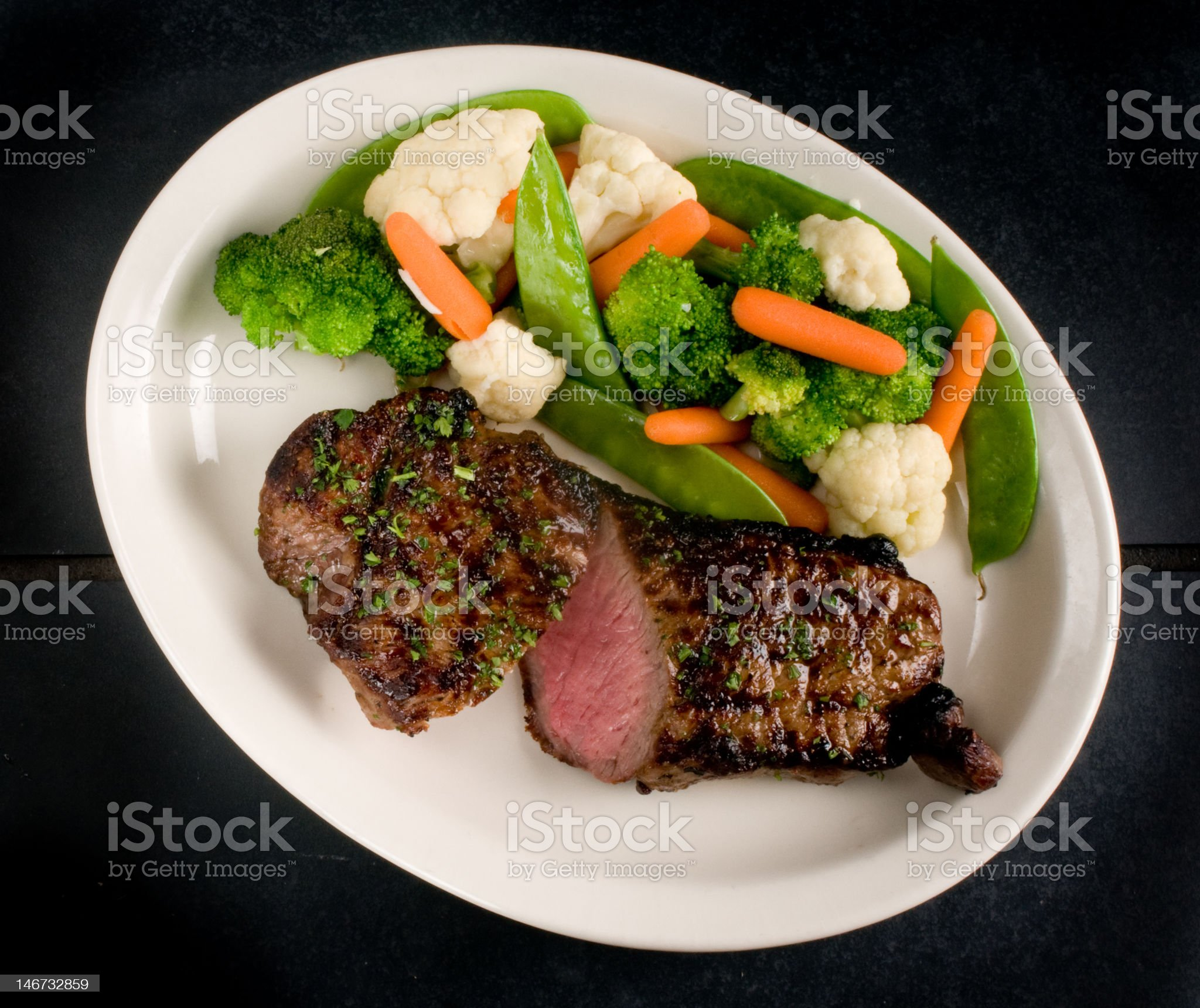 Sliced steak with steamed vegetables royalty-free stock photo