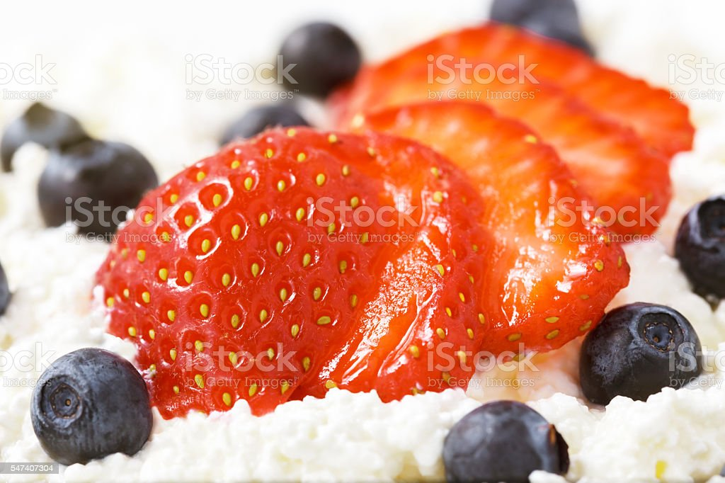 sliced strawberries and blueberries. close-up view stock photo