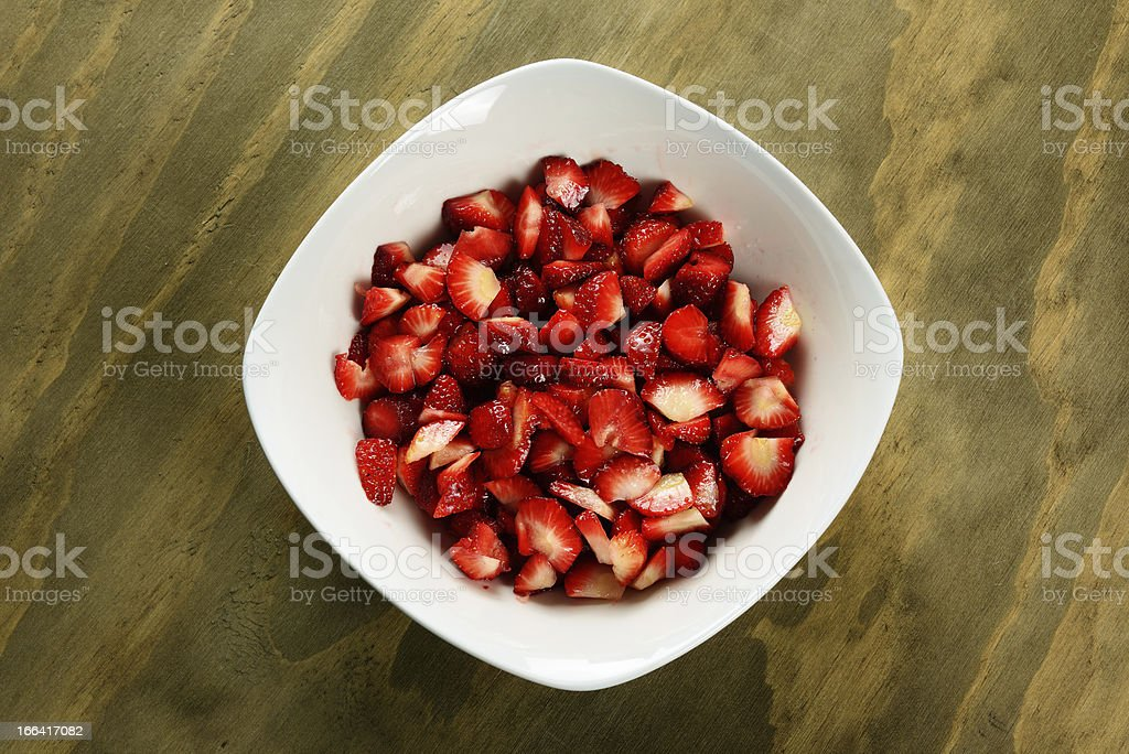 Sliced strawberries in a bowl royalty-free stock photo