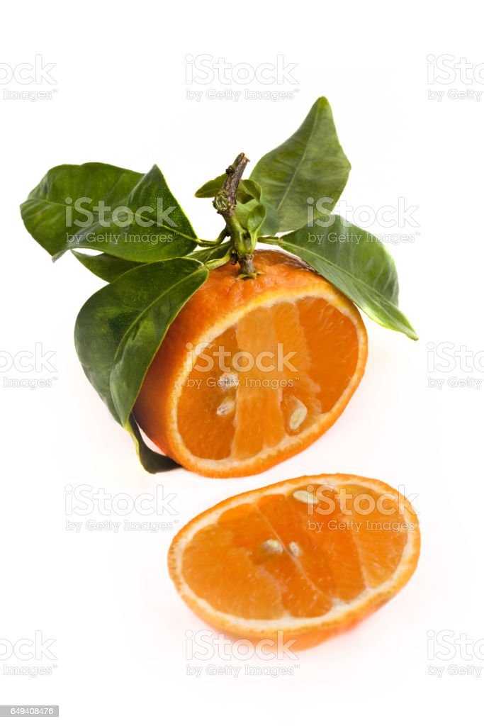 Sliced tangerine in the studio on the white stock photo
