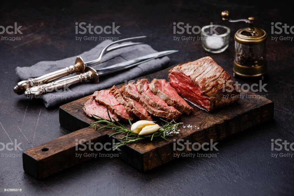 Sliced Tenderloin meat Roast beef and carving set stock photo