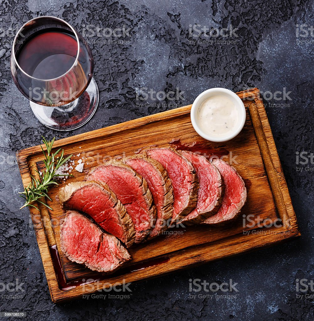 Sliced tenderloin Steak and Red wine stock photo