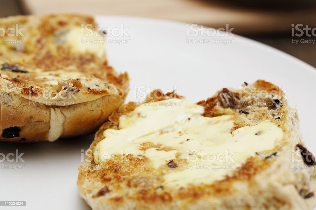 Sliced toasted and buttered hot cross bun stock photo