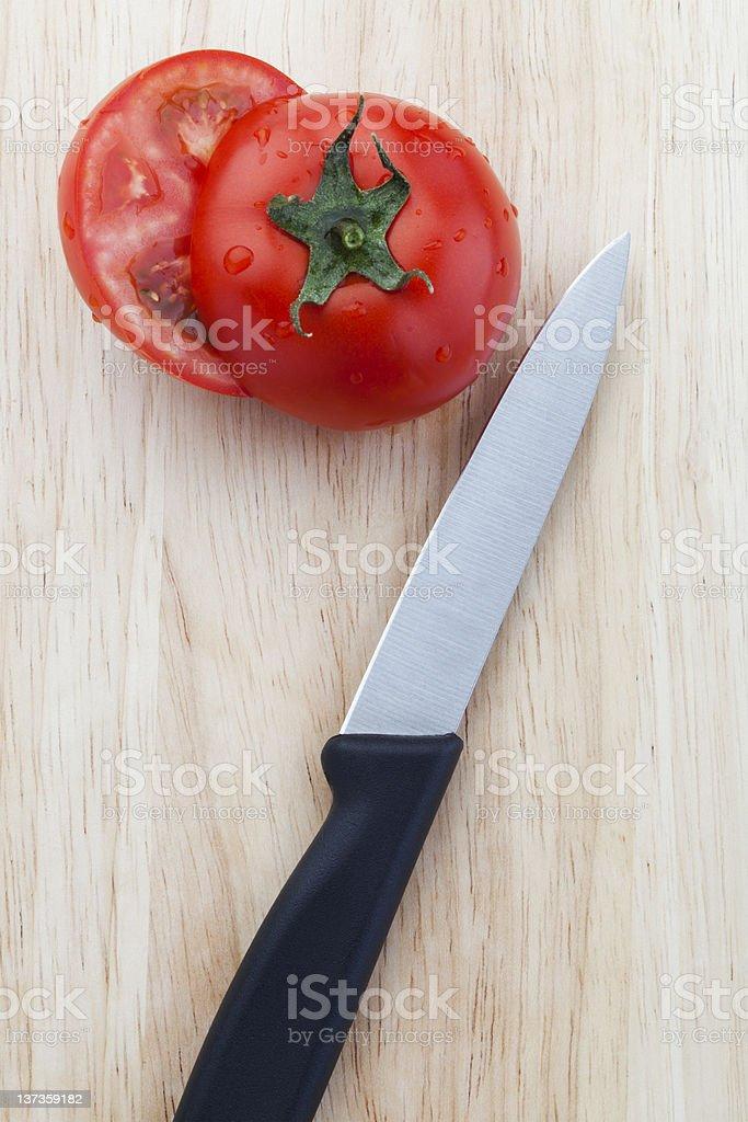 Sliced Tomato and sharp knife royalty-free stock photo