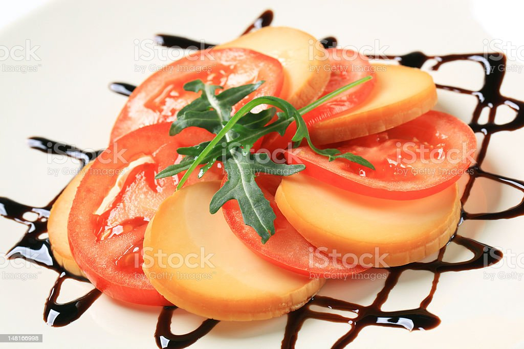 Sliced tomato and smoked cheese royalty-free stock photo