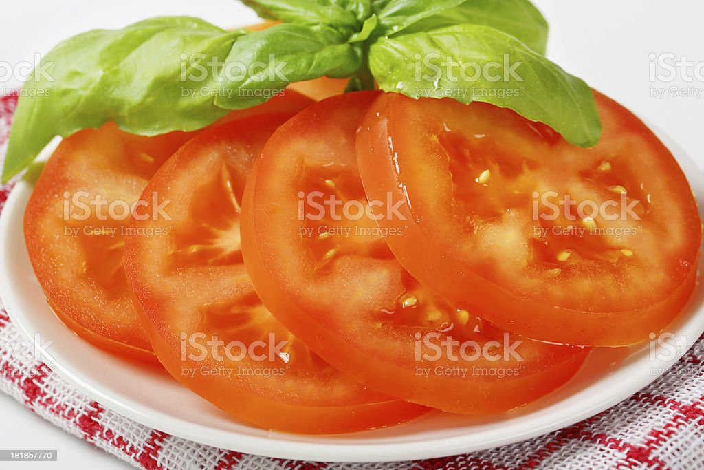 Sliced tomato on a white plate royalty-free stock photo