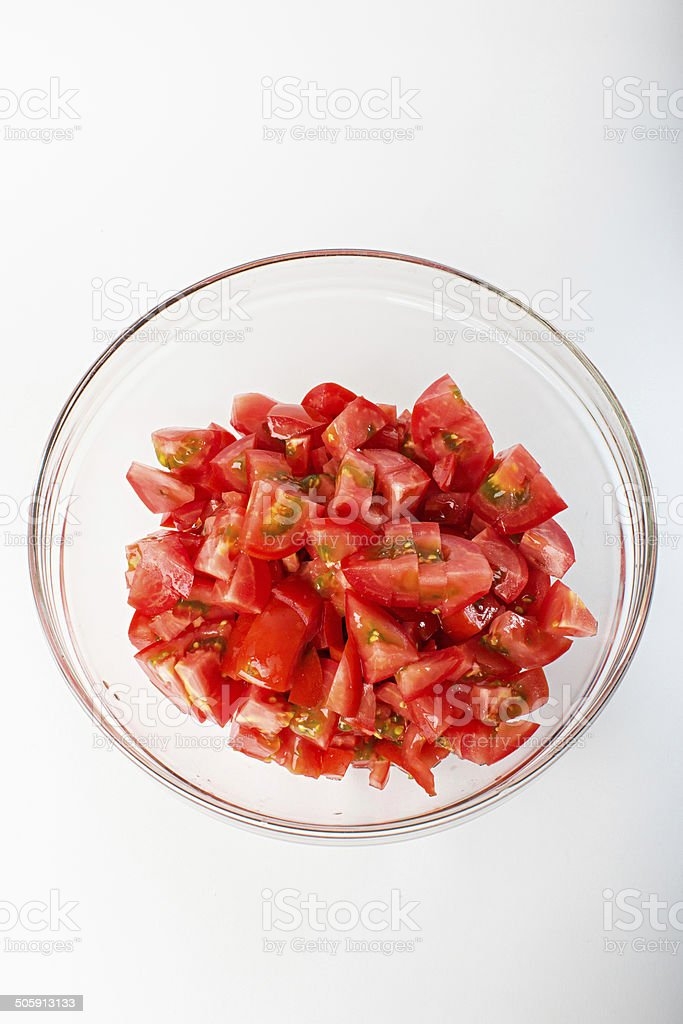 sliced tomato slices in a bowl stock photo