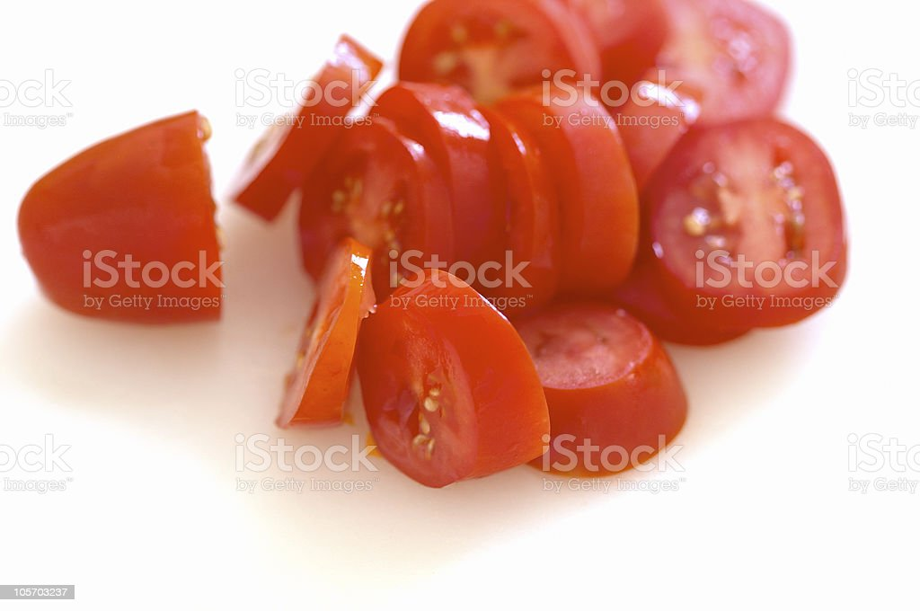 sliced tomatoes in the kitchen royalty-free stock photo