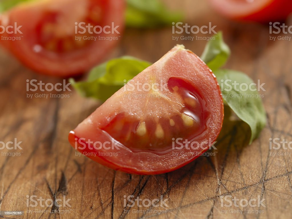 Sliced Tomatoes with Fresh Basil stock photo