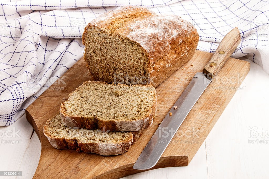 sliced traditional irish soda bread on a wooden board stock photo