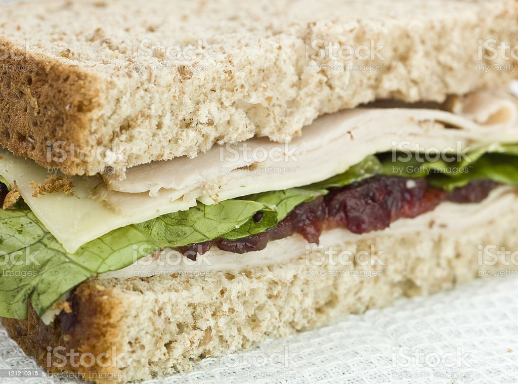 Sliced Turkey, cheese and cranberry Sandwich stock photo