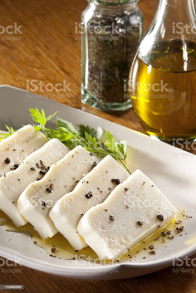 Sliced Turkish feta cheese with olive oil royalty-free stock photo