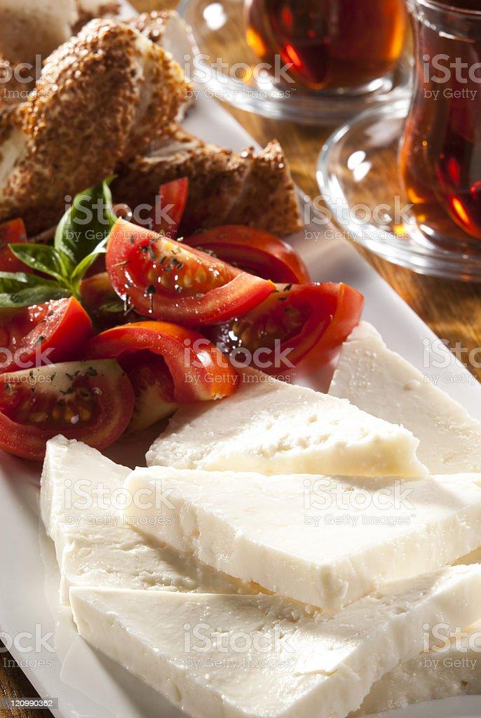 Sliced Turkish feta cheese with tea royalty-free stock photo