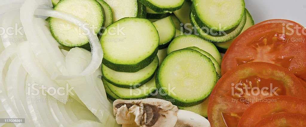 Sliced Vegetables Tomato Onion Zucchini and Mushrooms royalty-free stock photo