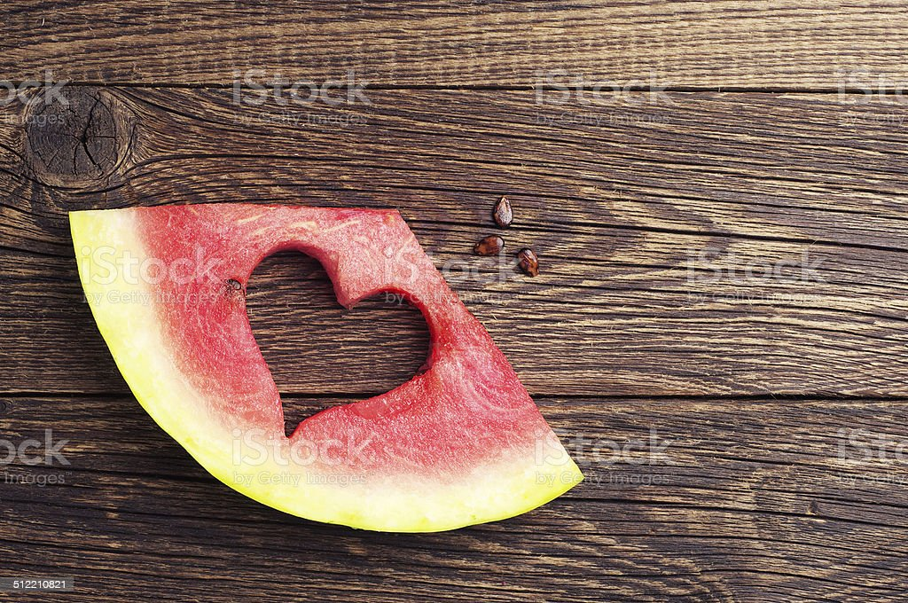 Sliced watermelon with cut in the shape of heart stock photo
