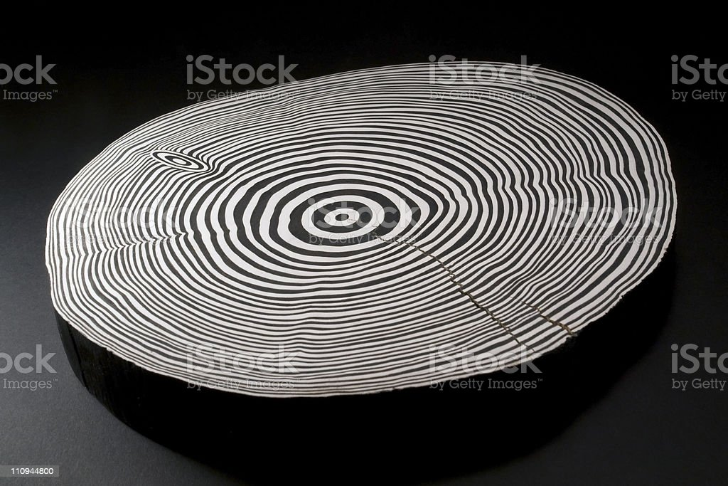 sliced wood with black and white annual rings royalty-free stock photo