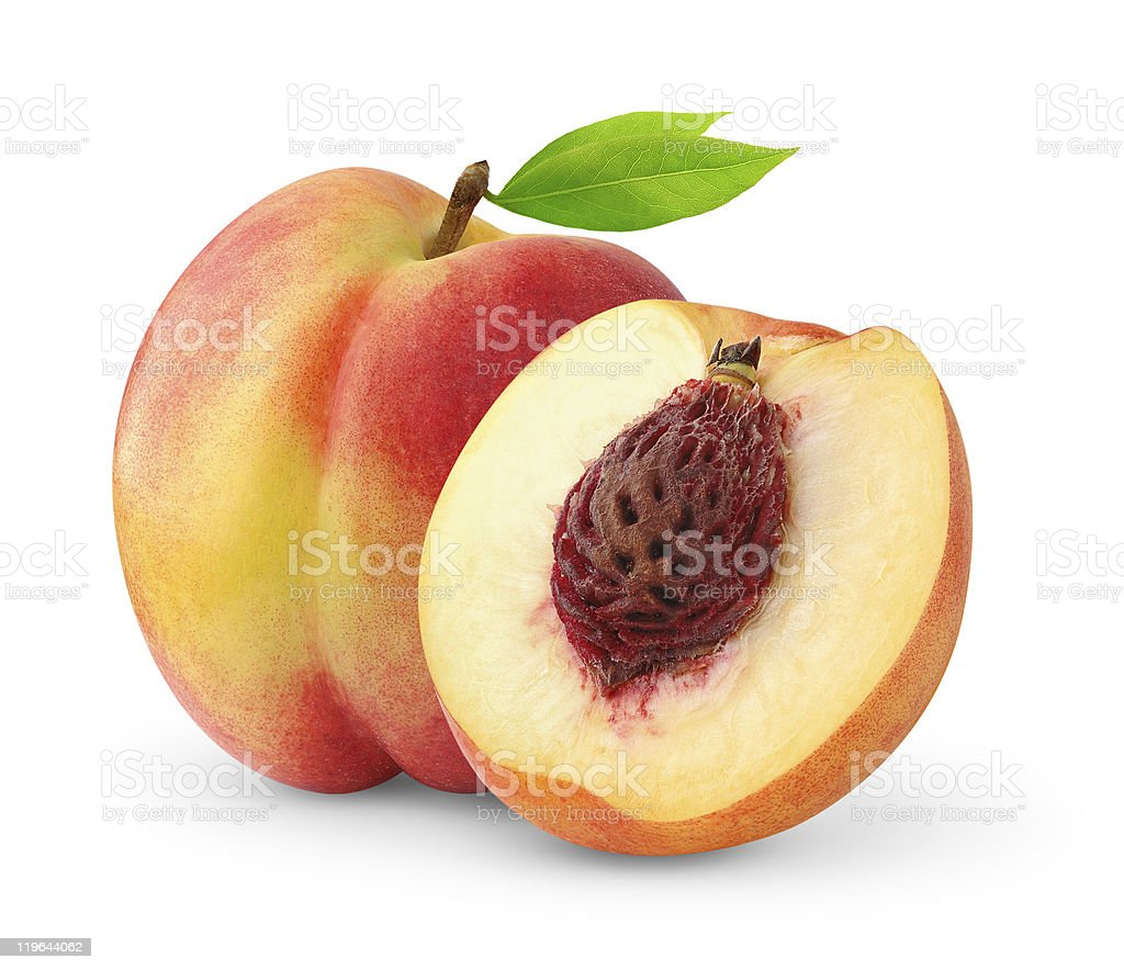 Sliced-open peach on a white background stock photo