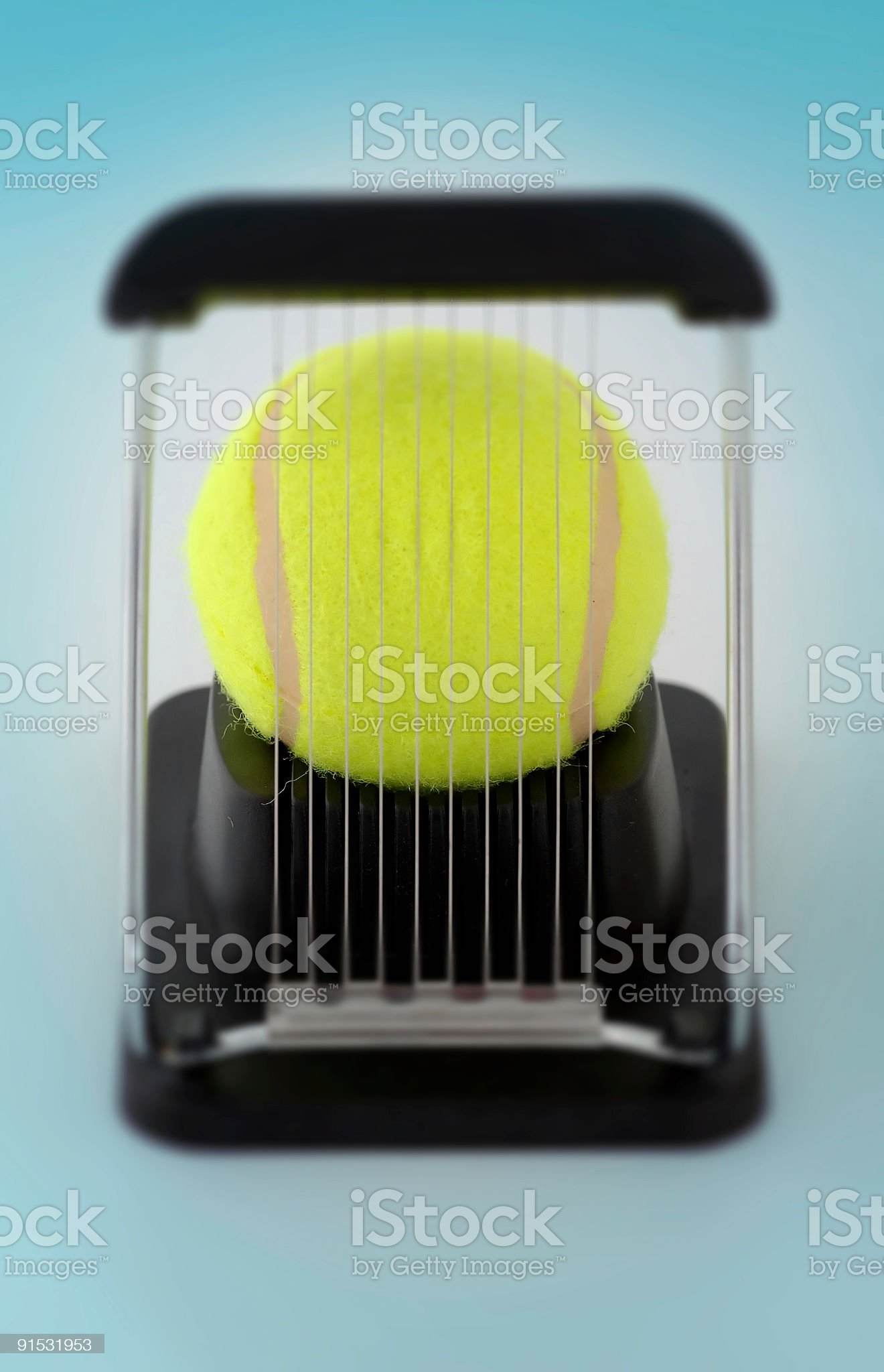 slicer with tennisball royalty-free stock photo