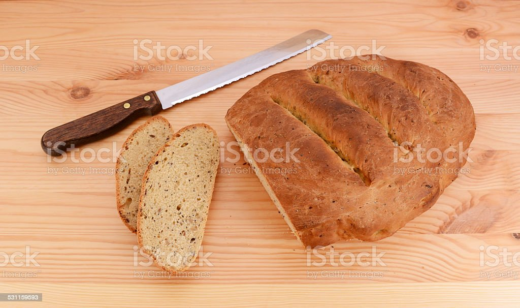 Slices cut from a multi seed malted loaf stock photo