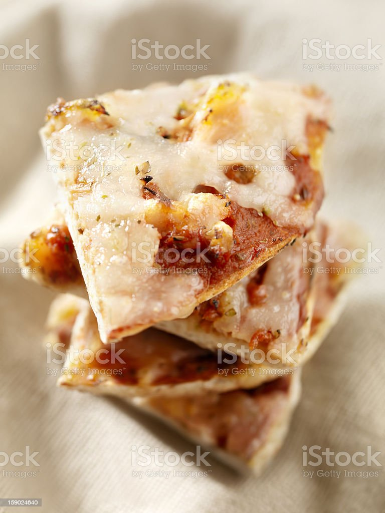 Slices of a Mini Pineapple Pizza stock photo