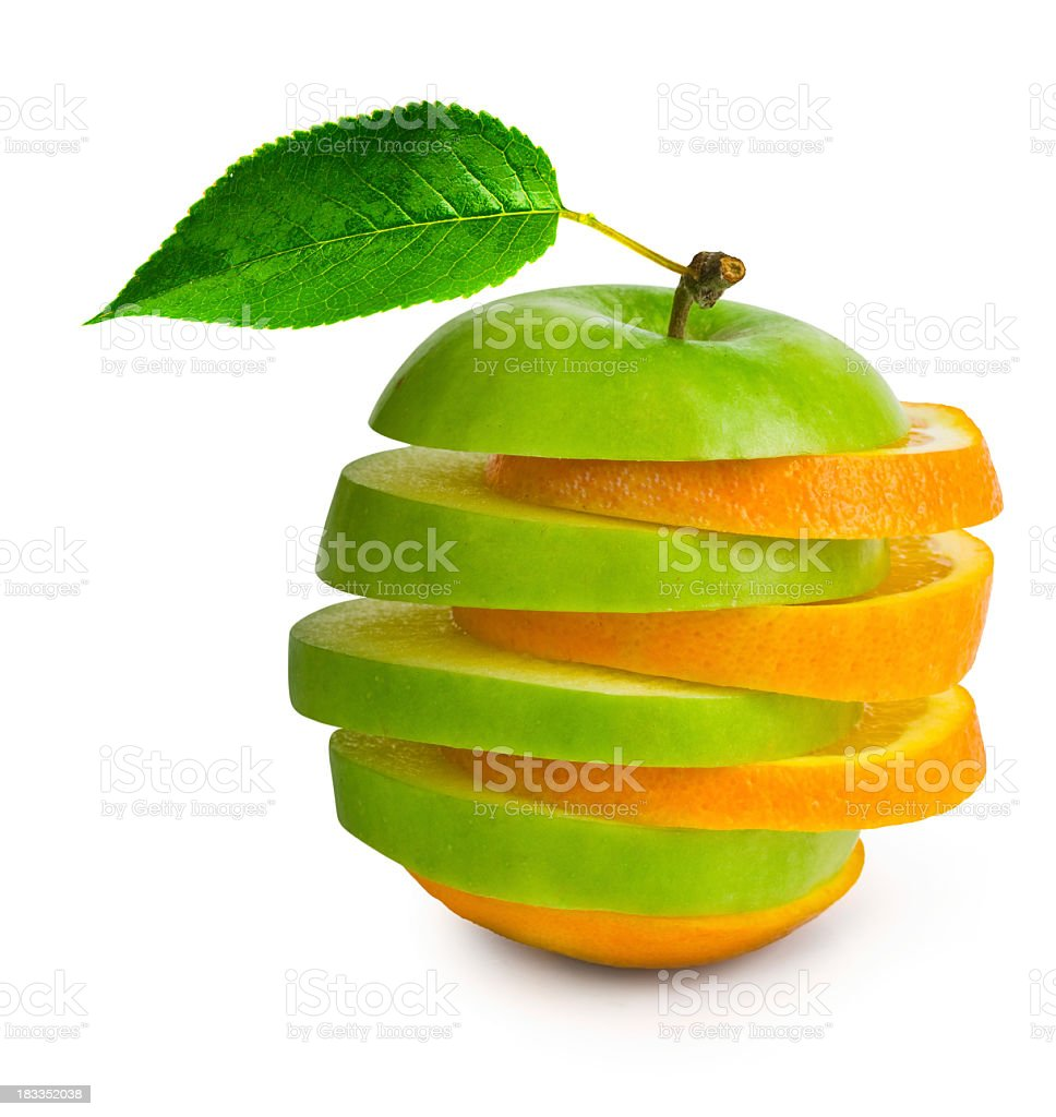 Slices of apples juxtaposed by slices of oranges stock photo