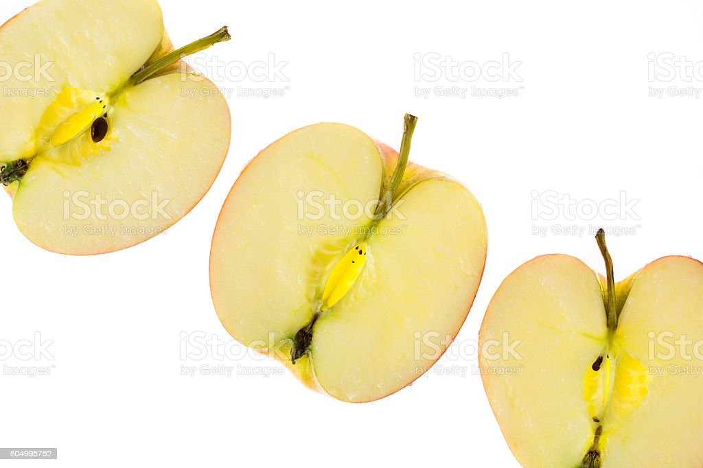 Slices of apples on a white background royalty-free stock photo