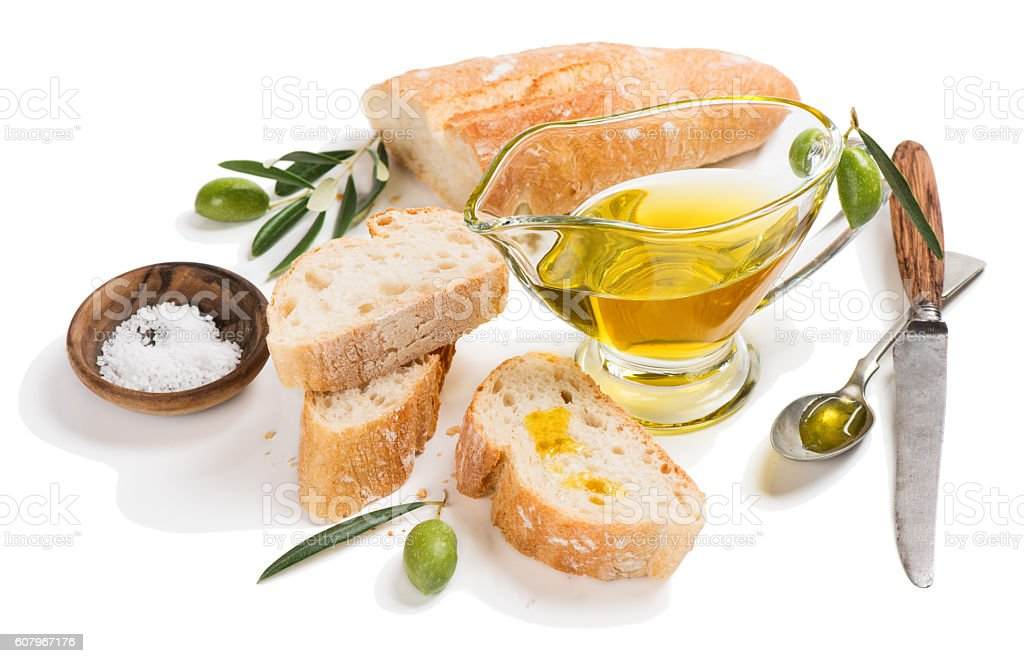 Slices of baguette and bowl of olive oil. stock photo