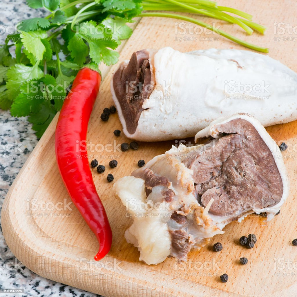 Slices of boiled beef tongue stock photo