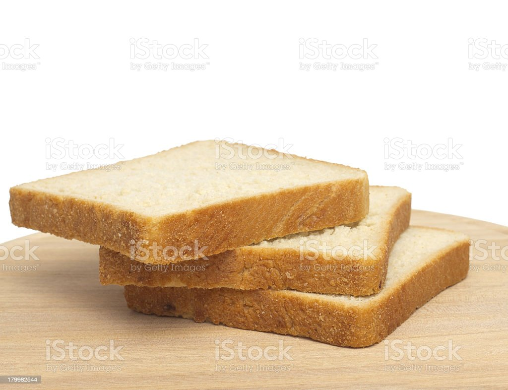 Slices of bread on white background royalty-free stock photo