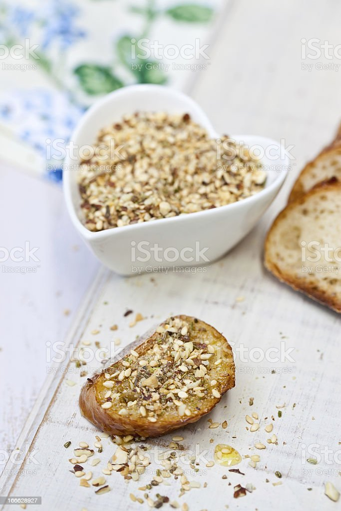 Slices of bread with seeds and olive oil royalty-free stock photo