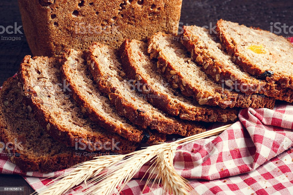 Slices of bread with spikelet of wheat stock photo