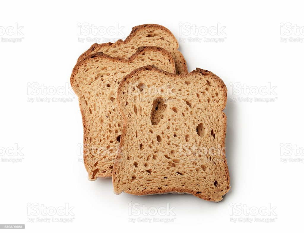 Slices of Brown Bread isolated on white background stock photo