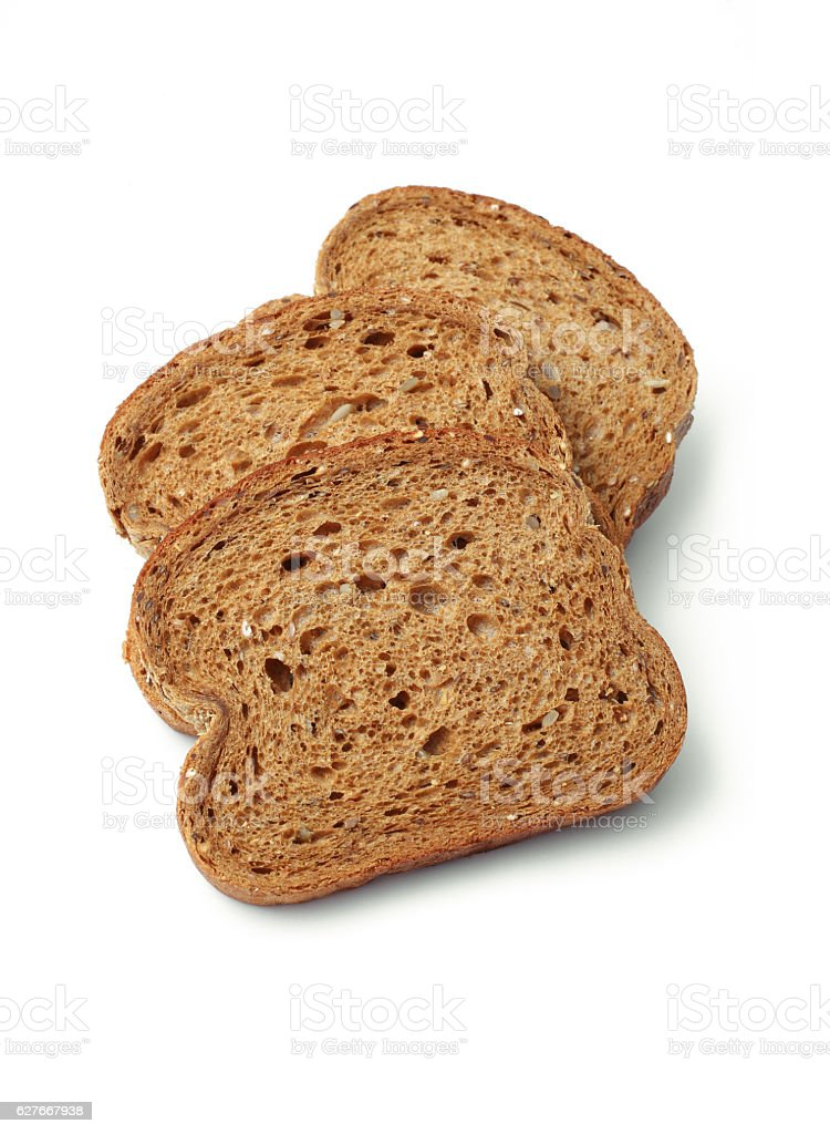 Slices of brown bread on white background stock photo