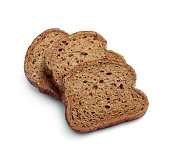 Slices of brown bread on white background