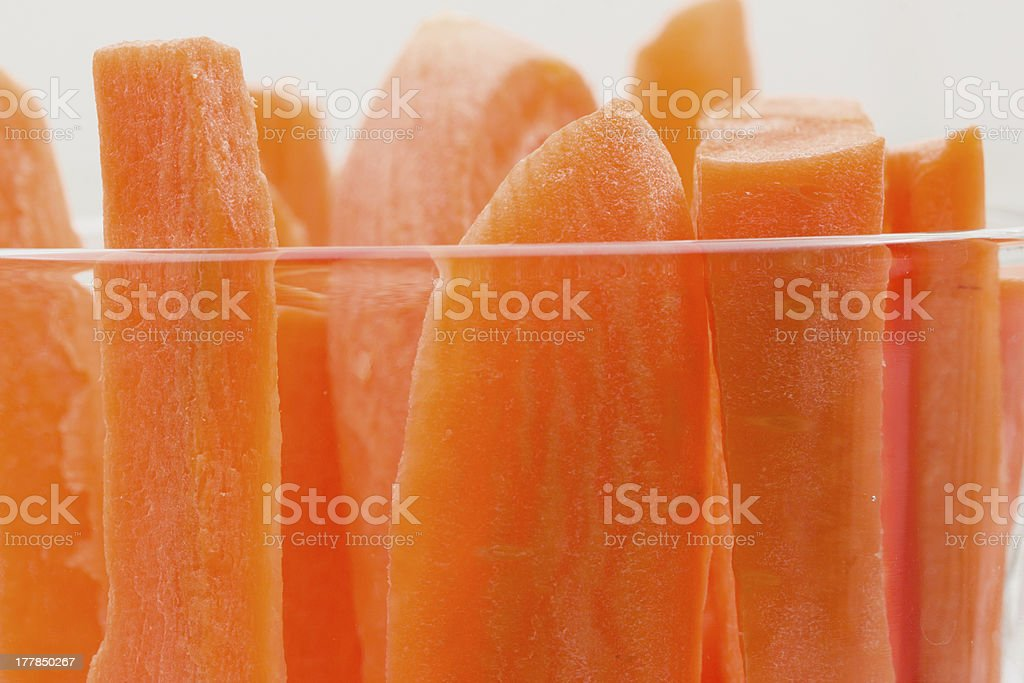 Slices of carrots in transparent glass cup royalty-free stock photo