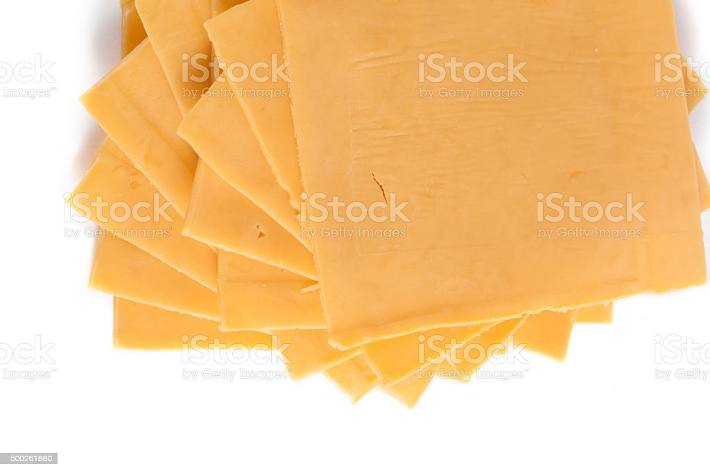 slices of cheddar cheese stock photo