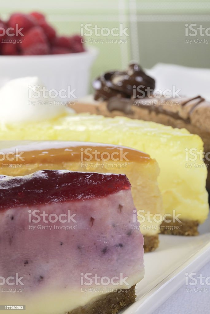 Slices of cheese cake with berries stock photo