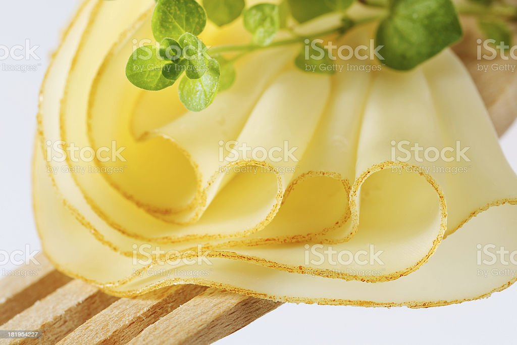 Slices of cheese on a wooden fork royalty-free stock photo