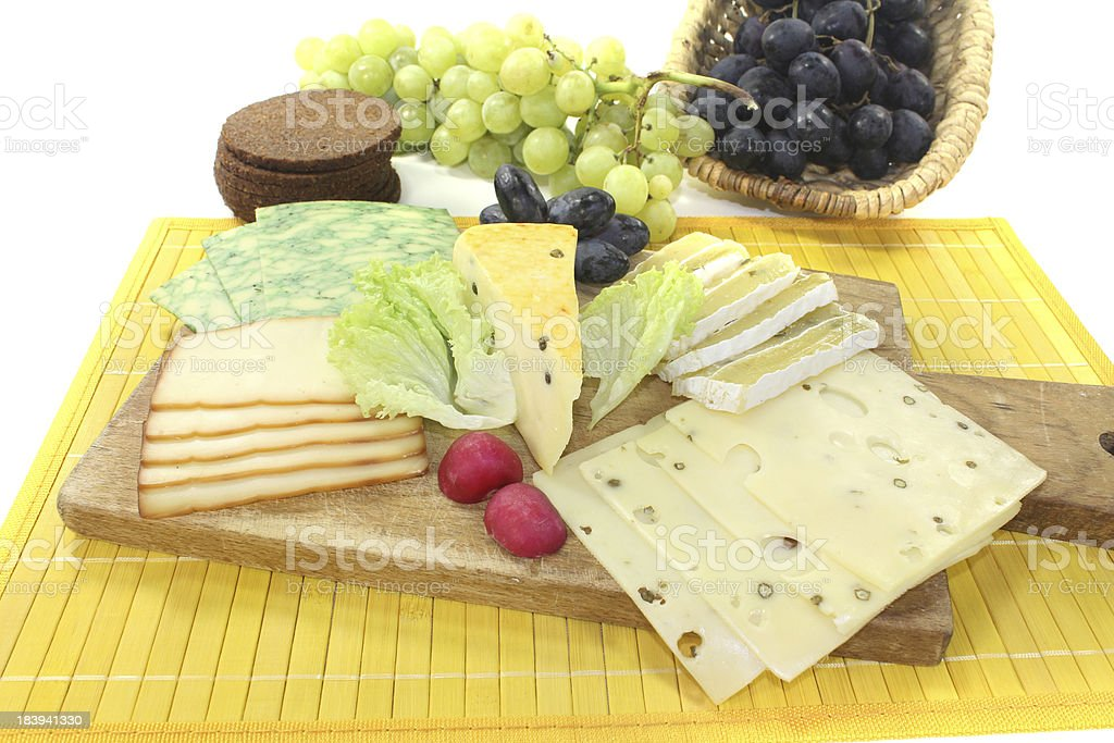 Slices of cheese with grapes stock photo