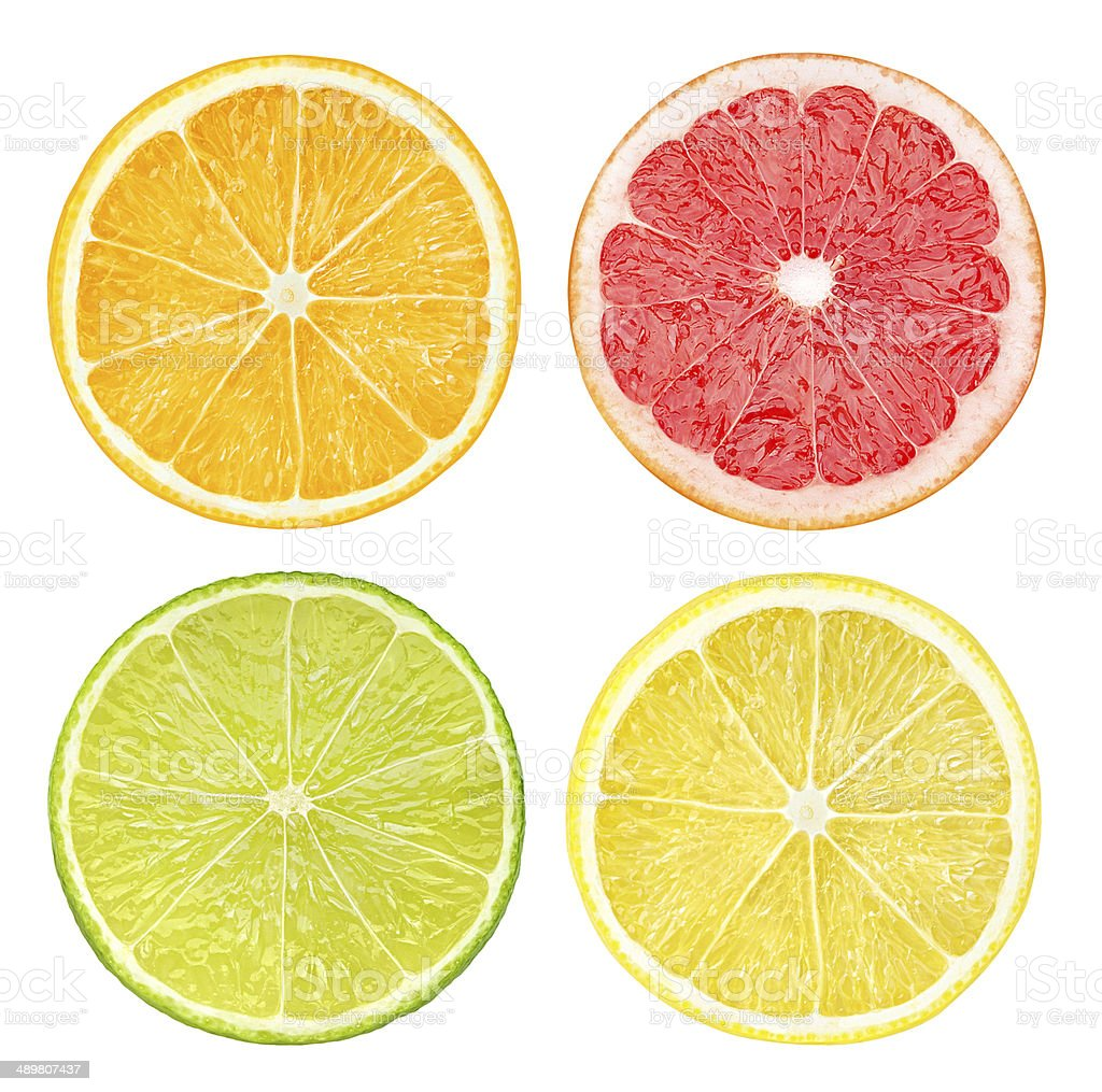 Slices of citrus fruits isolated on white stock photo