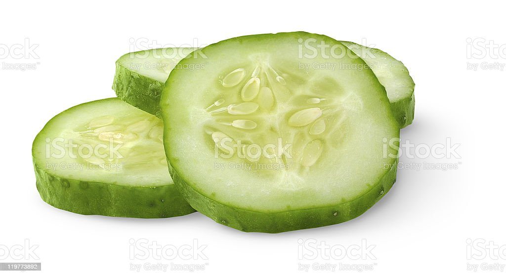4 slices of cucumber piled against a white background stock photo