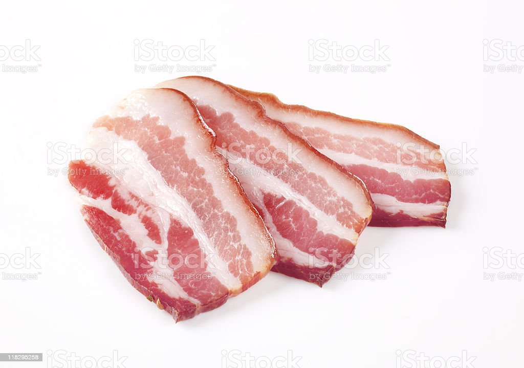 Slices of cured bacon royalty-free stock photo