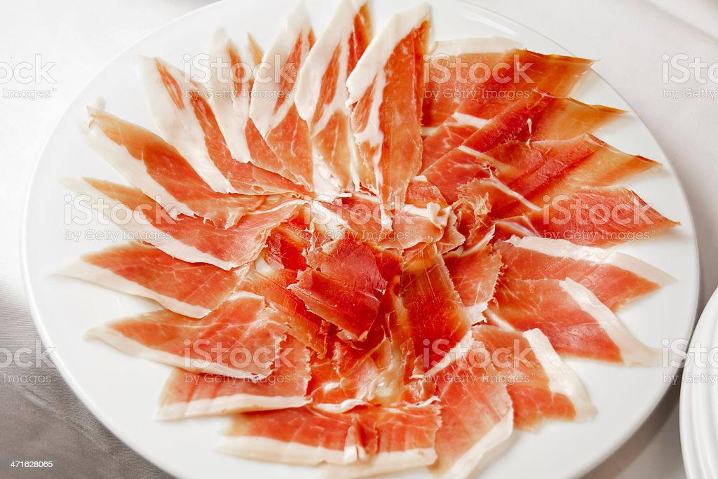 Slices of cured ham stock photo